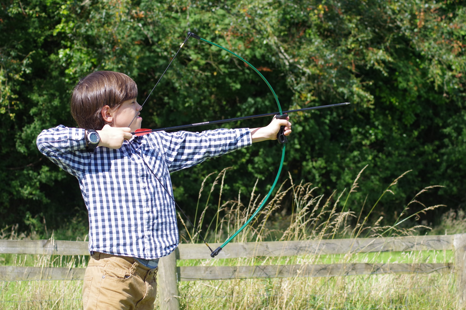 A picture of a child doing archery